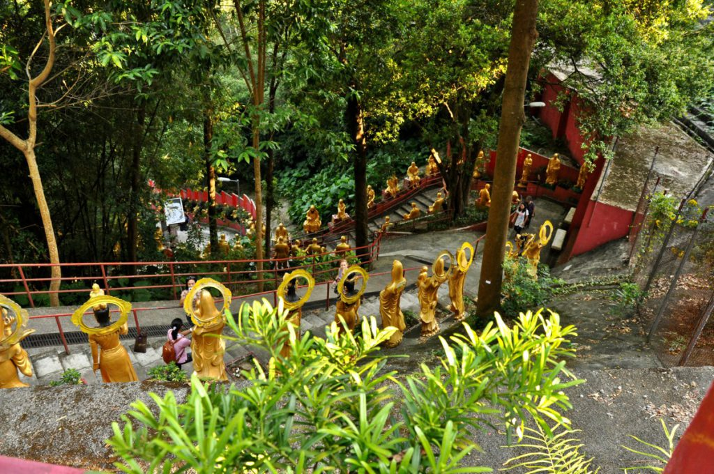 The way up to the 10000 Buddhas Monastery is paved with Buddha statues.